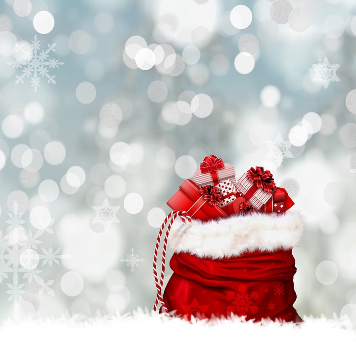 Christmas gifts in a red Santa bag with snowflakes in the background