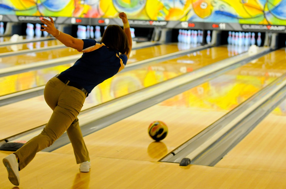 Bowler releasing ball down a lane