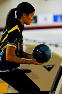 Woman about to release bowling ball