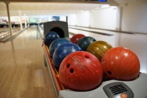 Closeup of bowling balls in ball return