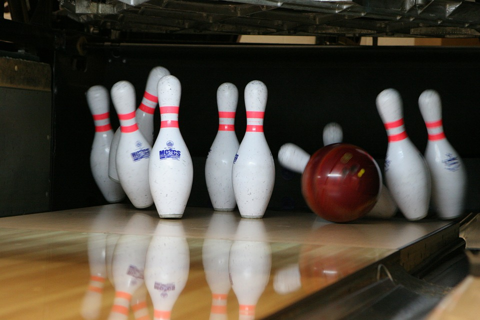 Bowling ball hitting bowling pins