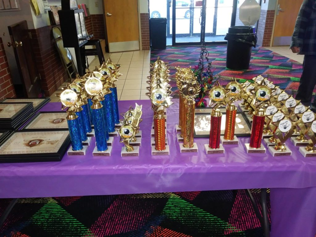 Table with bowling league trophies