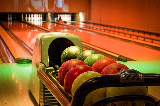 Close up of bowling balls in ball return