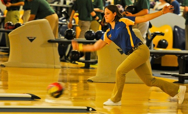 Action shot of woman bowling