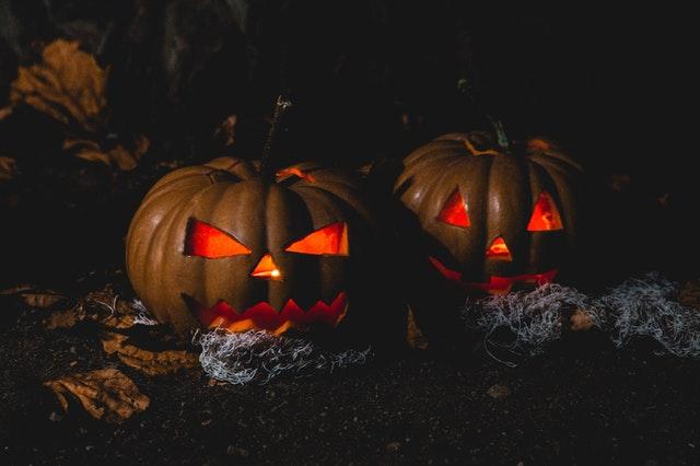 Two illuminated jack-o-lanterns for Halloween party