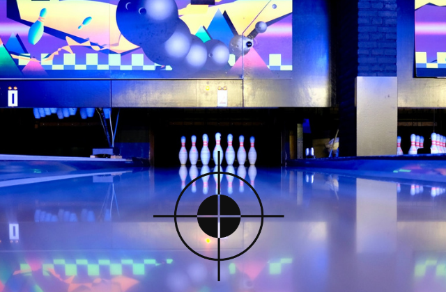 Bowling pins at end of lane with crosshairs