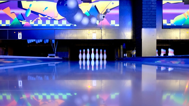 view of bowling lane with pins at end
